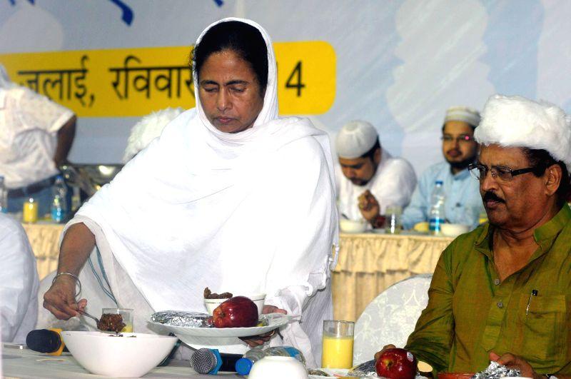 West Bengal Chief Minister Mamata Banerjee with West Bengal Panchayat Minister Subrata Mukherjee during an Iftaar Party in Kolkata on July 13, 2014. - Subrata Mukherjee