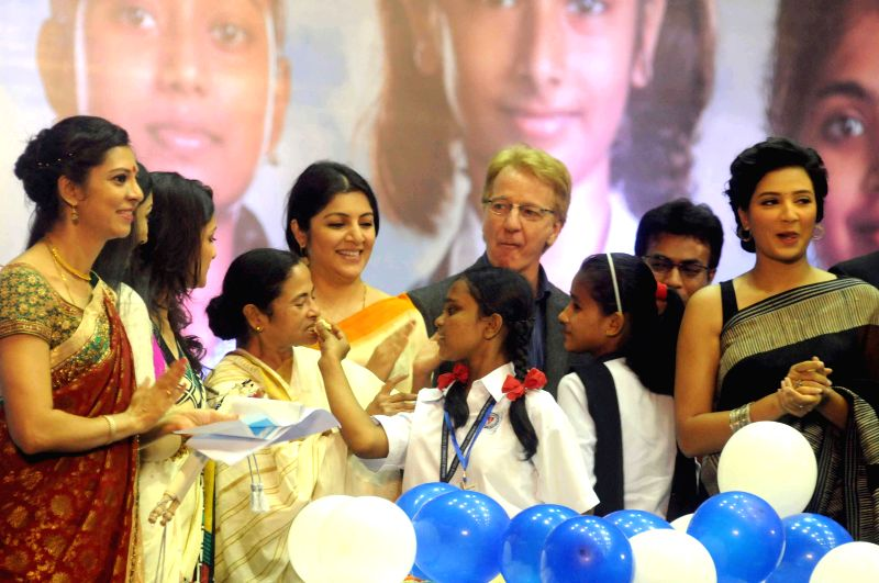 West Bengal Chief Minister Mamata Banerjee with actresses Locket Chatterjee, June Malia, Subhasree Ganguly, Tanusree Chakraborty and others during `Kanyashree`- a programme in Kolkata on Aug 14, ... - Mamata Banerjee, Locket Chatterjee, June Malia, Subhasree Ganguly and Tanusree Chakraborty