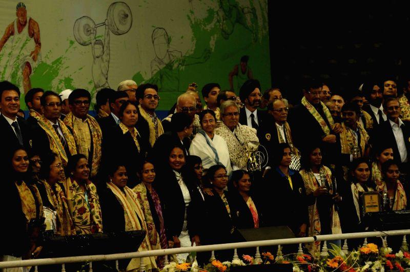 West Bengal Chief Minister Mamata Banerjee with veteran footballer P K Banerjee, veteran tennis player Akhtar Ali during Khel Samaman awards organised by West Bengal Sports Department in ... - Mamata Banerjee and P K Banerjee