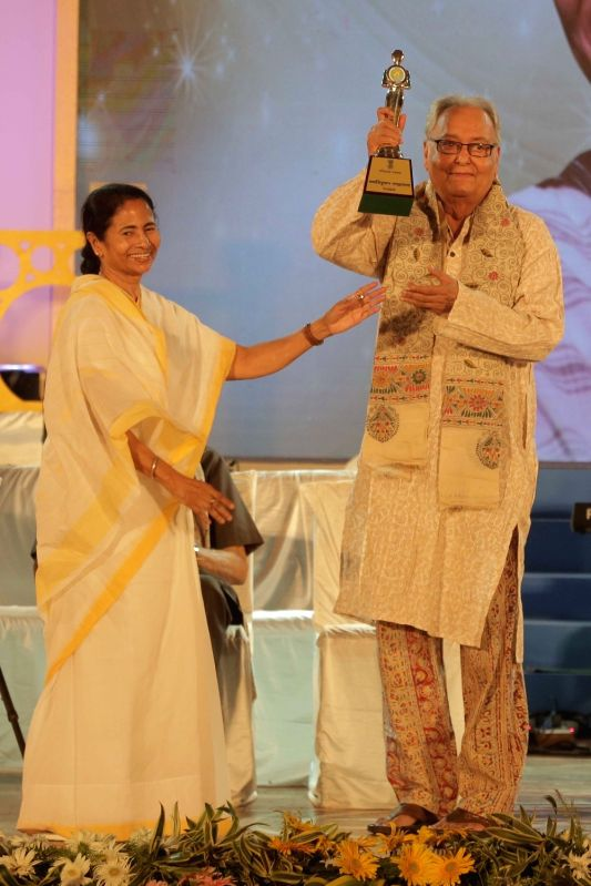 West Bengal Chief Minister Mamata Banerjeejee conferr Banga Samman award to actor Soumitra Chatterjee during Banga Samman, West Bengal's highest civilian award ceremony in Kolkata on May 20, ... - Mamata Banerjeejee and Soumitra Chatterjee