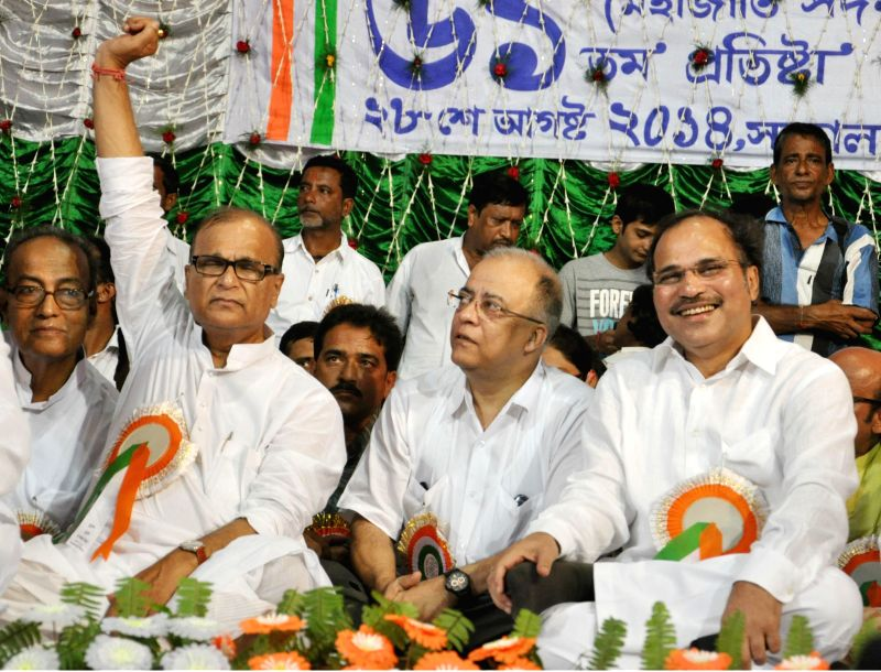 West Bengal Congress chief Adhir Ranjan Chowdhury and party leader Pradip Bhattacharya during a programme organised to celebrate the 61st foundation day of Chatra Parishad in Kolkata on Aug 28, 2014.