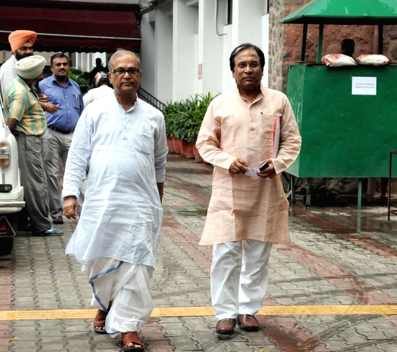 West Bengal Congress chief Pradip Bhattacharya comes out after meeting Chief Election Commissioner in New Delhi on May 5, 2014.
