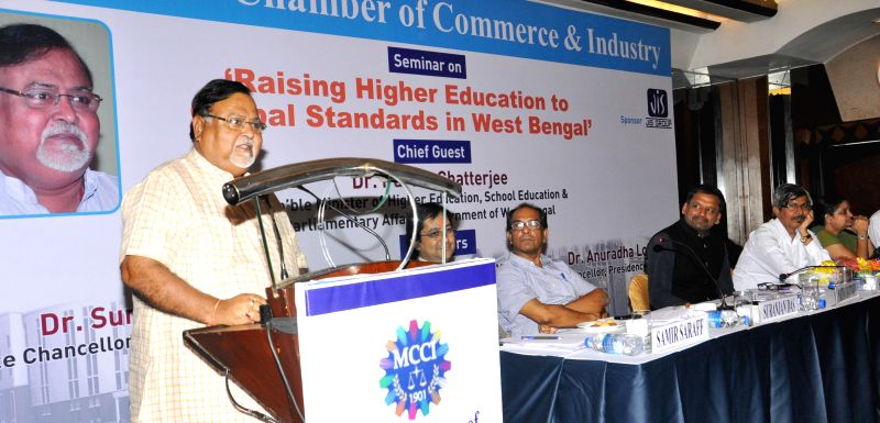 West Bengal Education Minister Partha Chatterjee addresses a seminar on `Raising Higher Education to Global Standards in West Bengal` in Kolkata on Aug 27, 2014. - Partha Chatterjee