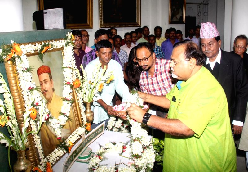 West Bengal Education Minister Partha Chatterjee pays tribute to Nepali poet Bhanubhakta Acharya on his birth anniversary in West Bengal Assembly in Kolkata on July 13, 2018. - Partha Chatterjee
