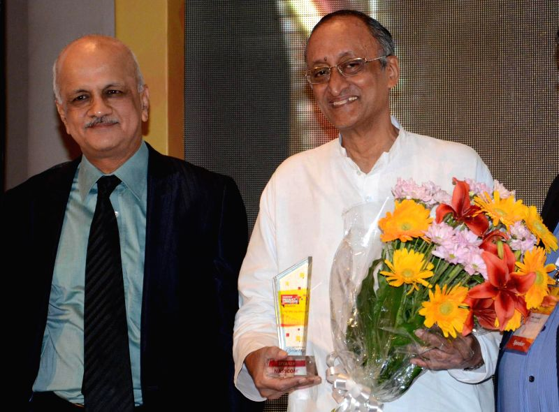 West Bengal Finance and Industry Minister Amit Mitra and NASSCOM President  R Chandrashekhar during 'NASSCOM Product Conclave' in Kolkata on July 18, 2014. - Amit Mitra