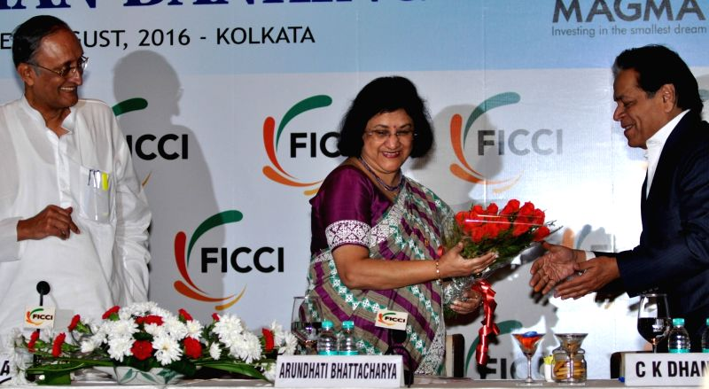 West Bengal Finance Minister Amit Mitra and State Bank of India Chairperson Arundhati Bhattacharya during the 13th Banking Conclave in Kolkata, on Aug 3, 2016. - Amit Mitra