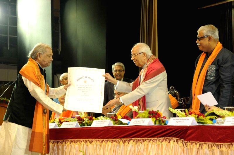 West Bengal Governor Keshari Nath Tripathi felicitates Kathak exponent Pandit Birju Maharaj with Doctor of Literature during the convocation of  the University of Calcutta in Kolkata, on Dec ... - Keshari Nath Tripathi
