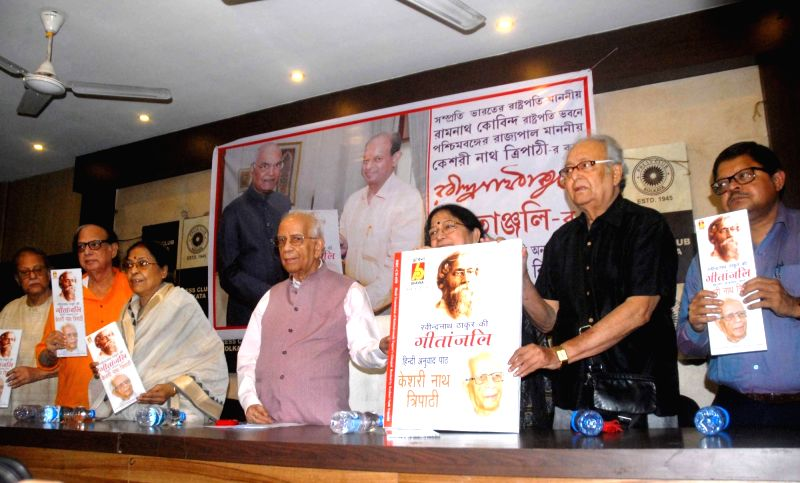 "West Bengal Governor Keshari Nath Tripathi, actor Soumitra Chatterjee and other dignitaries at the launch of Hindi translation (in CD format) of ""Gitanjali"" - a collection of poems ... - Soumitra Chatterjee and Keshari Nath Tripathi"