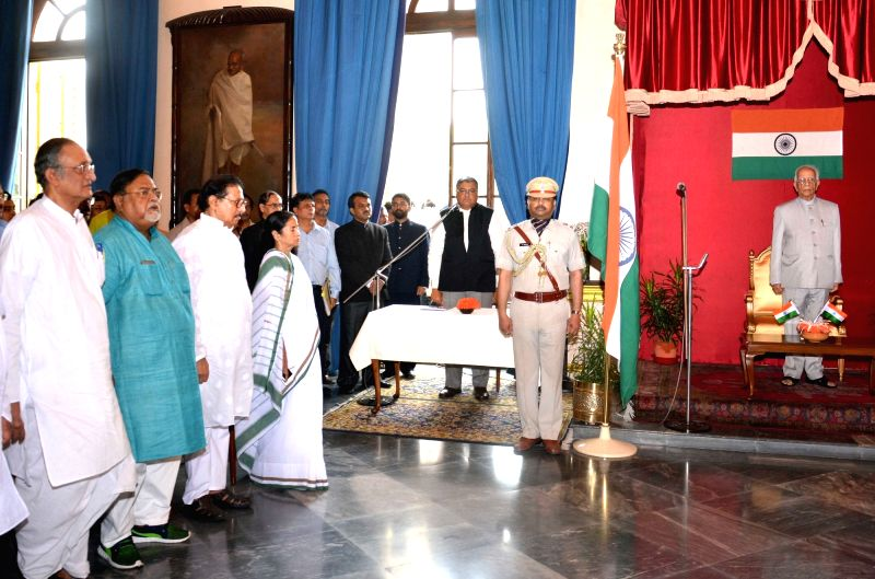 West Bengal Governor Keshari Nath Tripathi, Chief Minister Mamata Banerjee, Partha Chatterjee and Amit Mitra during swearing in ceremony at Ujjwal Biswas and Chandrima Bhattacharya at Raj Bhavan in ... - Mamata Banerjee, Keshari Nath Tripathi and Partha Chatterjee