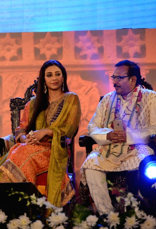 West Bengal Housing Minister and in-charge of Sports Arup Biswas, actress and Tabu during the closing ceremony of 21st Kolkata International Film Festival in Kolkata on Nov 21, 2015.