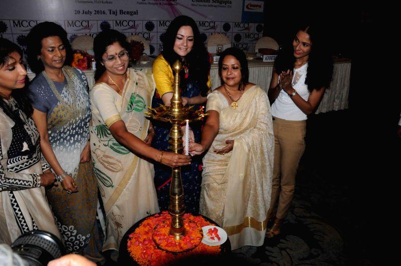 West Bengal minister Sashi Panja, fashion designer Agnimitra Paul, Congress leader Sharmistha Mukherjee and actress Ushoshi Sengupta during a seminar on 'Empowering Women' in Kolkata on July ... - Sashi Panja and Sharmistha Mukherjee