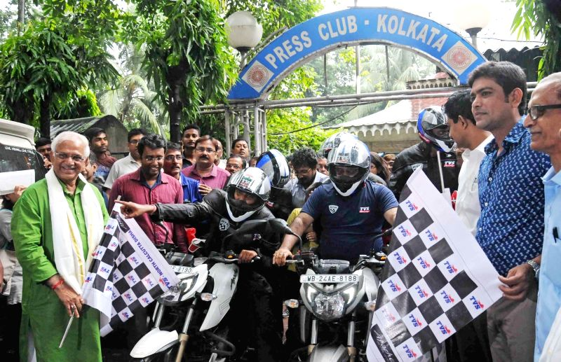 West Bengal Ministers Sovan Chatterjee, Laxmi Ratan Shukla, Rajib Banerjee flag off a motorcycle expedition in Kolkata, on Aug 10, 2016. The bikers are set to ride at 21,500 feet. - Sovan Chatterjee, Laxmi Ratan Shukla and Rajib Banerjee
