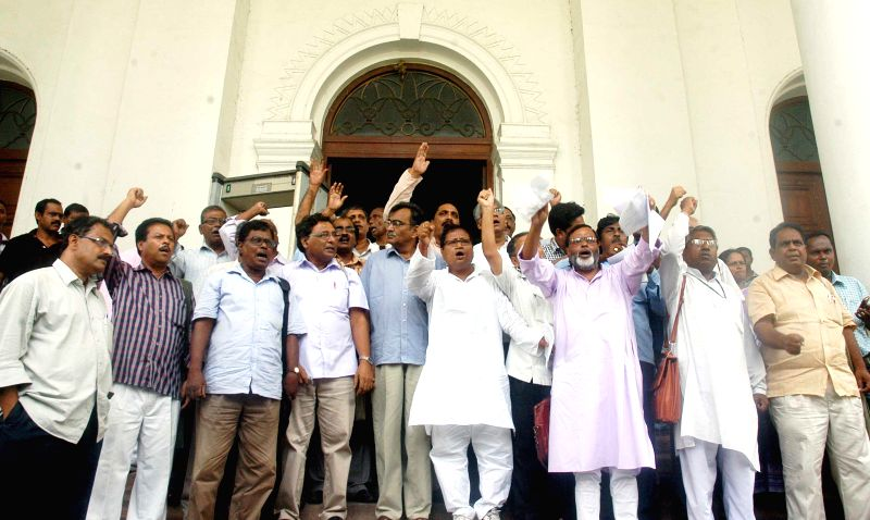 West Bengal opposition leader Surya Kanta Misra and other left MLA`s boycott the session of West Bengal Assembly to protest against alleged deterioration law and  order situation in Kolkata on June ..