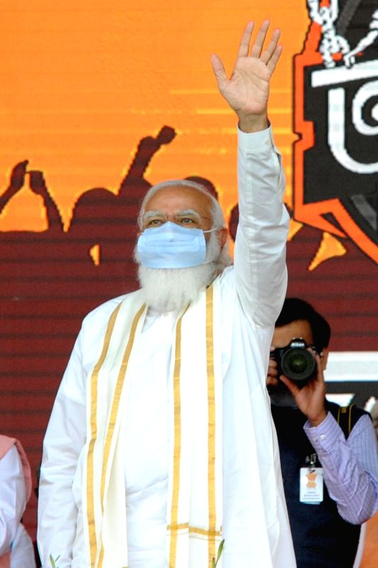 West Bengal: PM Narendra Modi during a public meeting ahead of State Assembly Election at Hooghly district in West Bengal on Monday 22nd February 2021. (Photo: Kuntal Chakrabarty/IANS)