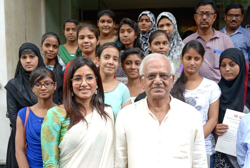 "West Bengal Power Minister Sovandeb Chattopadhyay, Easynotes Pvt. Ltd Managing Director Shalini Biswas along with underprivileged girl children during an initiative ""A Step Towards ... - Sovandeb Chattopadhyay"