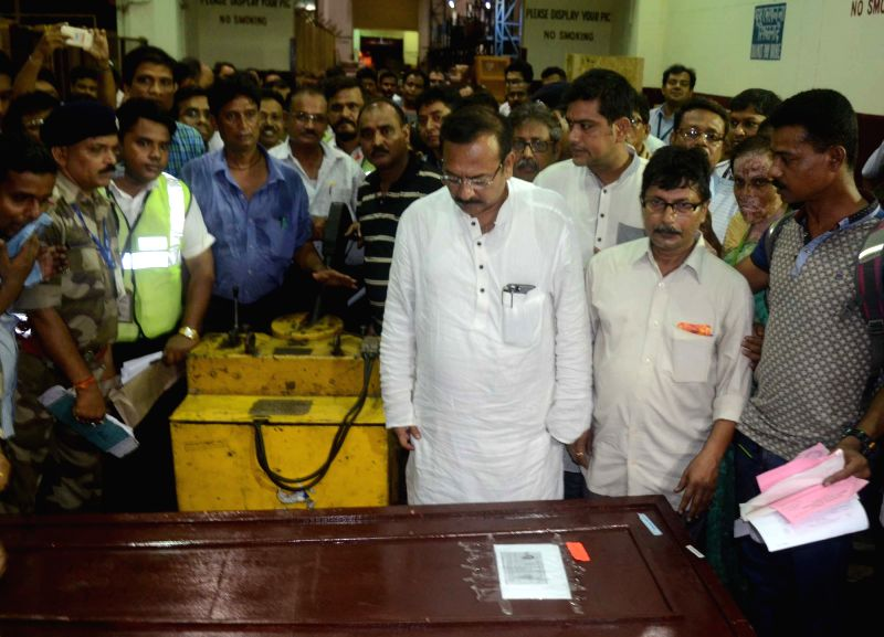 West Bengal Sports Minister Aroop Biswas receives the coffins of Paresh Chandra Nath and Gautam Ghosh who died on Everest last year and their bodies were recovered by a eight member Sherpa ... - Aroop Biswas, Paresh Chandra Nath and Gautam Ghosh