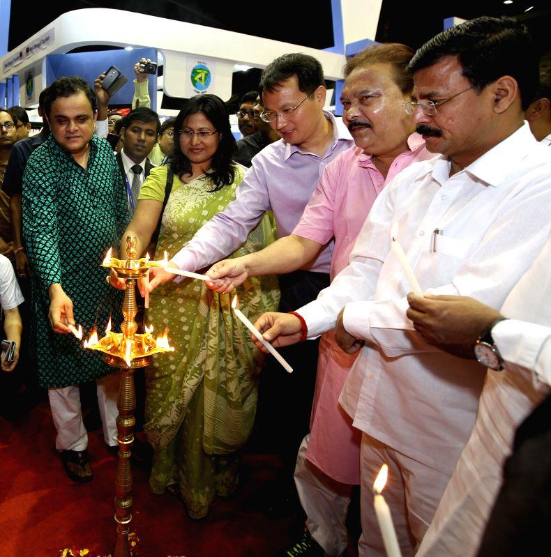 West Bengal Tourism Minister Bratya Basu, West Bengal Sports and Transport Minister Madan Mitra and Uttarakhand Tourism Minister Dinesh Dhanai during inauguration of Travel Tourism Fair at Netaji ... - Bratya Basu