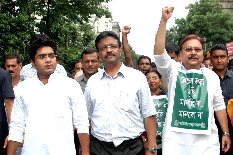 West Bengal Transport Minister Madan Mitra and Urban development Minister Firhad Hakim and other Trinamool Congress workers demonstrate against rail tariff hike in Kolkata on June 23, 2014. - Madan Mitra