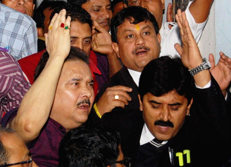 West Bengal Transport Minister Madan Mitra being taken to be produced at a Kolkata Court in connection with multi-crore-rupee Saradha chit fund scam in Kolkata, on Jan 2, 2015.