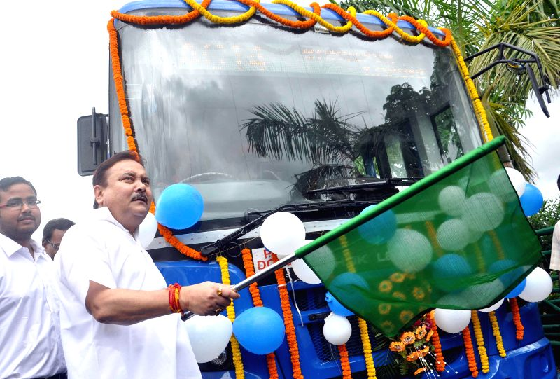 West Bengal Transport Minister Madan Mitra flags-off new bus service which include a fleet of 4 air-conditioned and 33 non-air-conditioned buses at New Town in Kolkata on Sept 1, 2014. - Madan Mitra