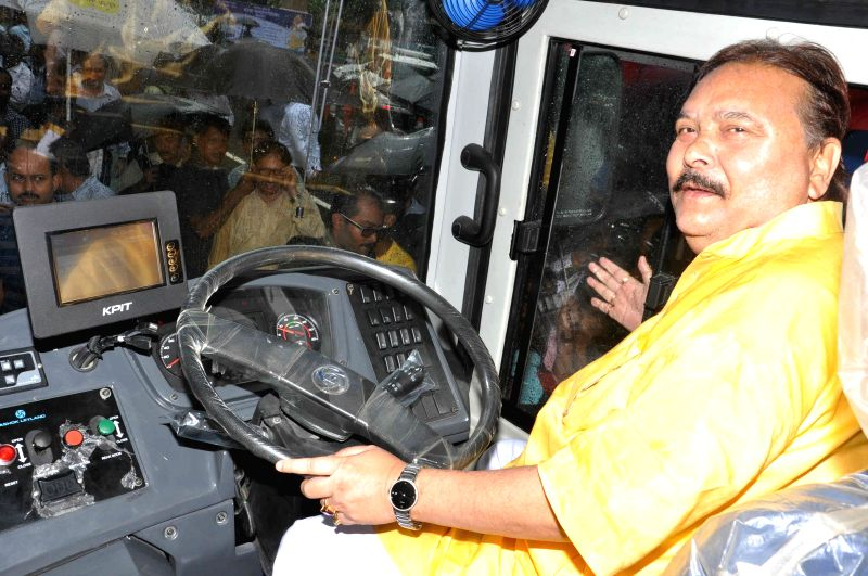 West Bengal Transport Minister Madan Mitra sits on the driver's seat of a bus during a programme organised to launch `Jan Bus` in Kolkata on July 30, 2014. - Madan Mitra