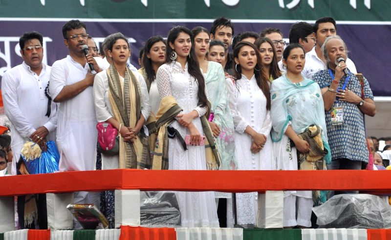 West Bengal Urban Development and Municipal Affairs Minister Firhad Hakim with artists from the Bengali entertainment industry during their Trinamool Congress' (TMC) 25th Martyr's Day rally, ... - Firhad Hakim