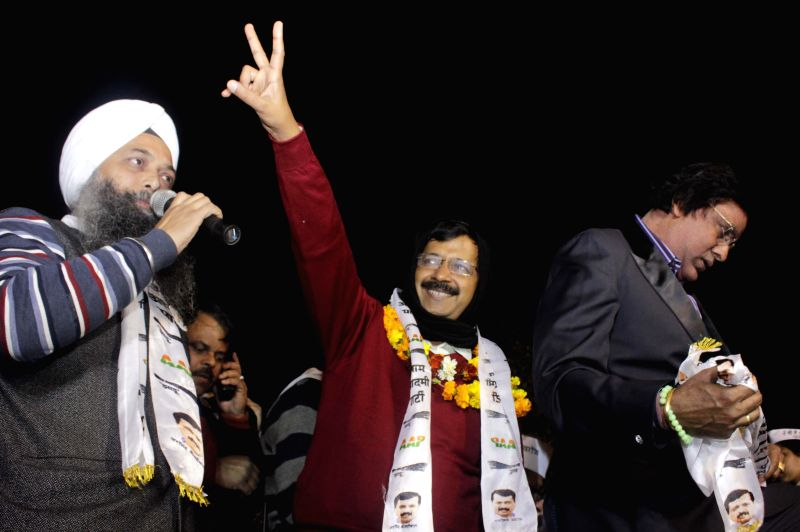 West Delhi: Aam Aadmi Party (AAP) chief Arvind Kejriwal addresses during a rally for the upcoming Delhi Assembly Election at Rajori Garden in West Delhi on Feb. 4, 2015.