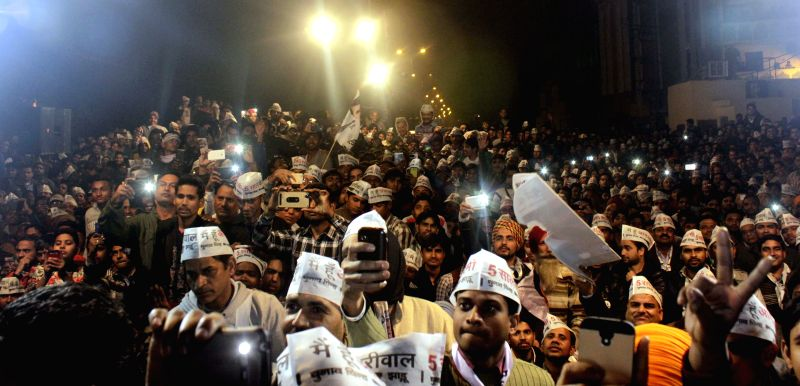 West Delhi: Supporters of Aam Aadmi Party (AAP) during a rally for the upcoming Delhi Assembly Election at Rajori Garden in West Delhi on Feb. 4, 2015.