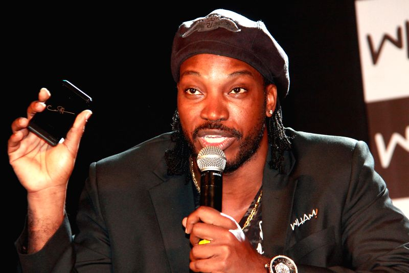 West Indian cricketer Chris Gayle during a press conference where he was named the brand ambassador of Wham mobile phones in India, in Bangalore on April 30, 2014.