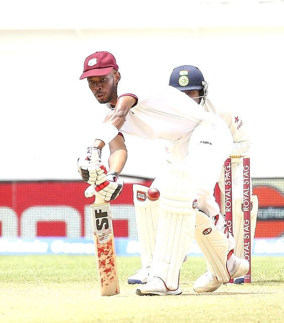 West Indies cricketer Roston Chase in action during the second test match between India and West Indies at Kingston, Jamaica, on Aug 4, 2016.