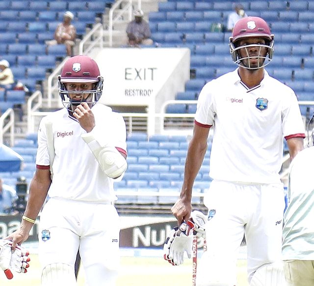 West Indies cricketers Shane Dowrich and Roston Chase during the second test match between India and West Indies at Kingston, Jamaica, on Aug 4, 2016.