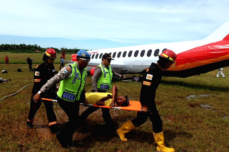 WEST SUMATERA, May 23, 2017 - Rescuers evacuate a passenger during an emergency management air accident drill at Minangkabau airport in West Sumatera, Indonesia, May 23, 2017.