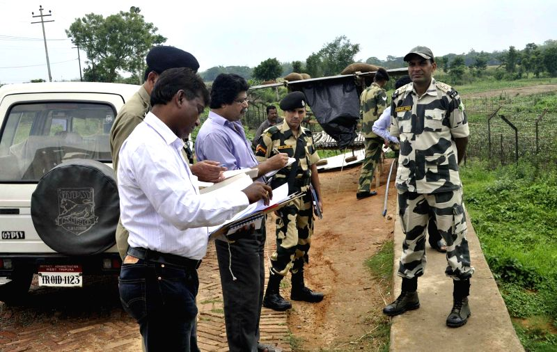 West Tripura district officials and BSF personnel verify the spot where the villagers living in the Indian territory outside the border fencing will be relocated at Jaynagar area in the outskirts of .