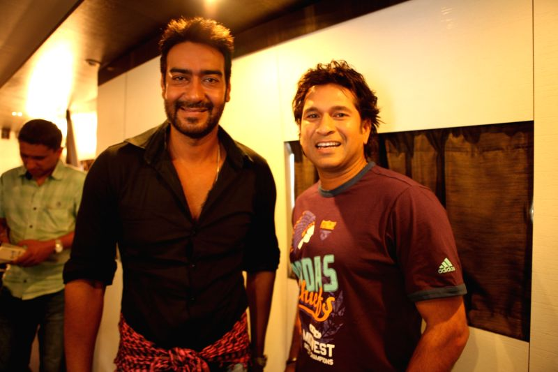 When Bollywood actor Ajay Devgn met cricketer Sachin Tendulkar. - Ajay Devgn and Sachin Tendulkar