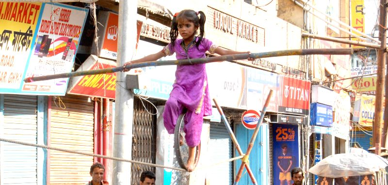 While thousands of people every month still get the girl child illegally aborted, the parents of this ten-year-old Roshni are fully dependent on her as she feeds the family by displaying her tight ...