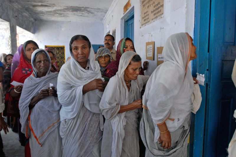 Widows of Vrindavan queue-up to cast their vote at a polling booth in Vrindavan of Uttar Pradesh's Mathura district on April 24, 2014.