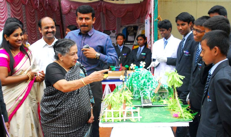Wife of Bharata Ratna CNR Rao, Indumathi Rao at `PRERANA 2014` -Inter-School Science Exhibition organised at a school in Bangalore on July 10, 2014. - Indumathi Rao
