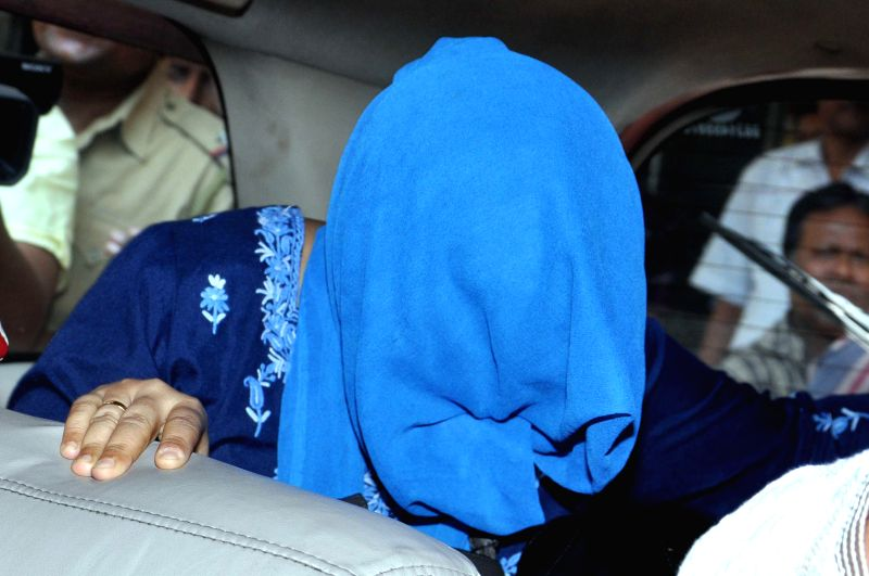 Wife of Saradha Group chief Sudipta Sen, Piyali Sen being taken to be produced in a court of Kolkata for her alleged involvement in the multi-crore Saradha Group chit fund scam in Kolkata on April ...