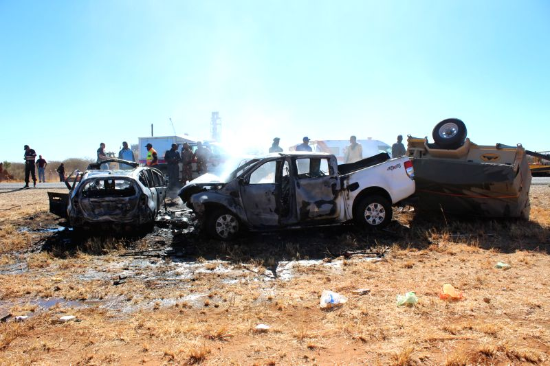 WINDHOEK, Aug. 10, 2018 - Destroyed vehicles are seen at the site where two vehicles collided on the B1 road between Otjiwarongo and Otavi in northern Namibia, on Aug. 10, 2018. Eight people died in ...