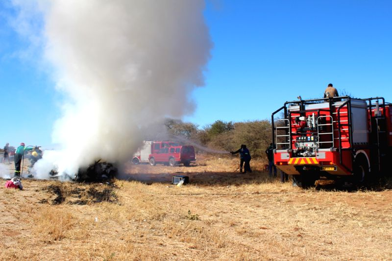WINDHOEK, Aug. 10, 2018 - The Otjiwarongo Municipality fire brigade puts out the fire on two vehicles that collided on the B1 road between Otjiwarongo and Otavi in northern Namibia, on Aug. 10, 2018. ...