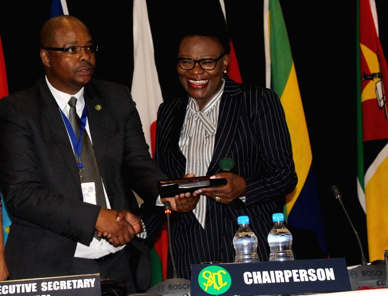 WINDHOEK, Aug. 9, 2018 - Selma Ashipala-Musavyi (R), Namibia's Permanent Secretary of the Ministry of International relations and Cooperation, takes over the chair of the Standing Committee of the ...