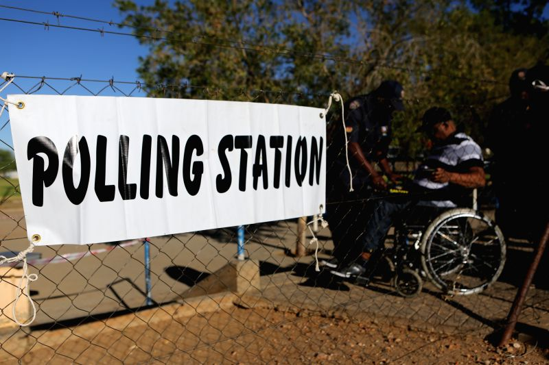 Windhoek (Namibia): A man goes through security check at a tation in Windhoek, capital of Namibia, Nov. 28, 2014. Namibia on Friday held the fifth post-independence presidential election and National