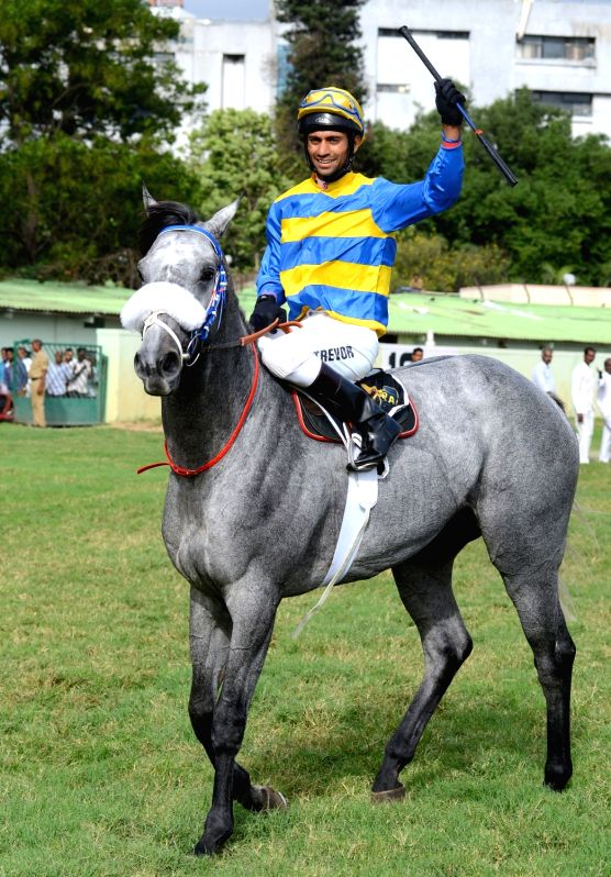 Winner Jockey Trevor Patel astride on Sir Cecil horse exults after winning the Kingfisher Ultra Derby 2018 at Race Course, in Bengaluru on July 15, 2018. - Jockey Trevor Patel