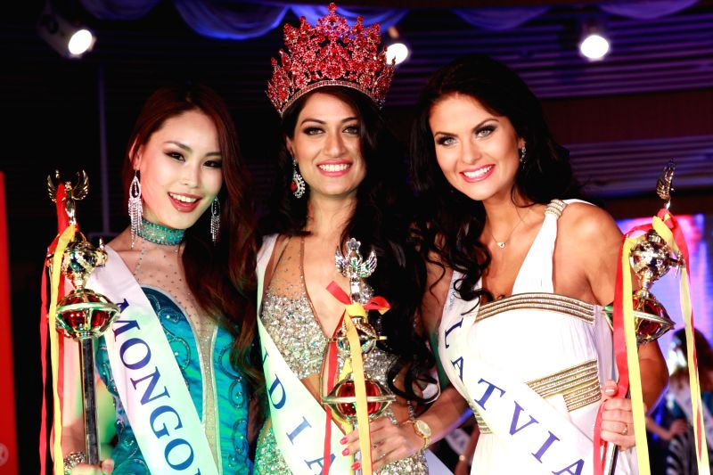 Winner of Miss Asia Pacific 2012 flanked by 1st Runner up - Tuyanaa Temenjargal of Mongolia and 2nd Runner up Diana Kubasova of Latvia on either side.