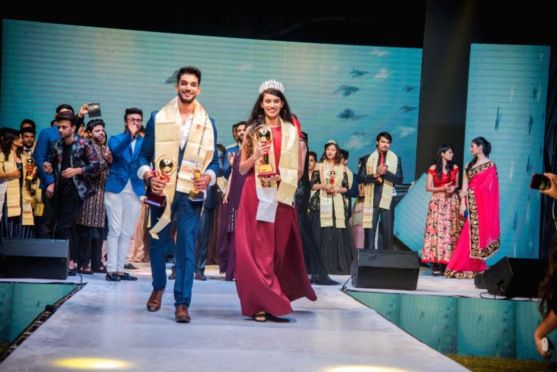 Winners of Grand finale of Glambirds Entertainment Mr & Miss Subcontinental India 2017 walks the ramp in New Delhi on Nov 18, 2017.