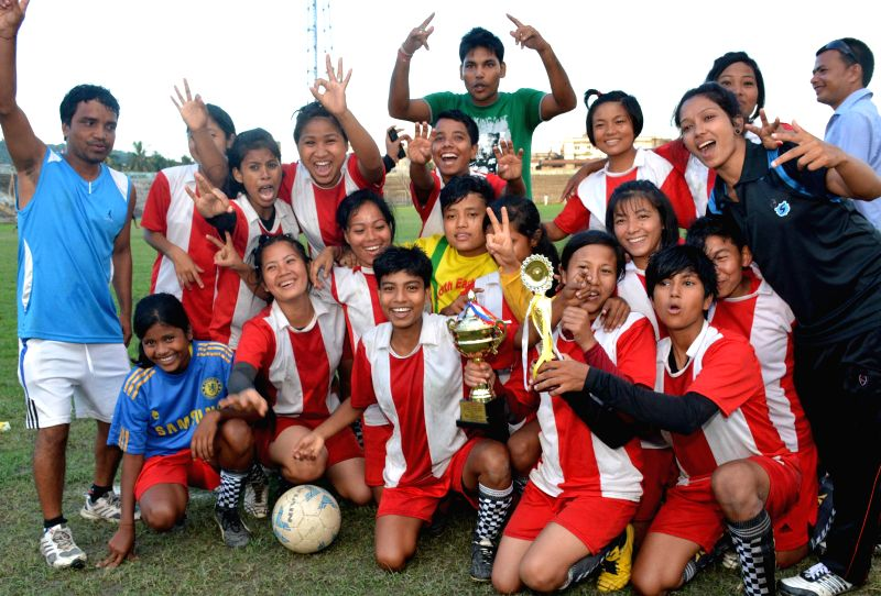 Winning team Kiyang Khasia Memorial Tribal High School, Hailakandi receives the trophy from State Sports & Youth Welfare minister Ajit Singh after defeating Dakhin Mazbat High School, Udulguri by - Ajit Singh