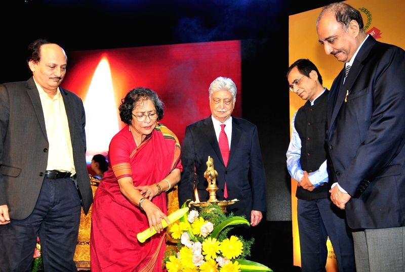 Wipro Chairman Azim Premji and other dignitaries during the lighting of lamp to inaugurate the 158th Income Tax Day celebrations, in Bengaluru on July 24, 2018.