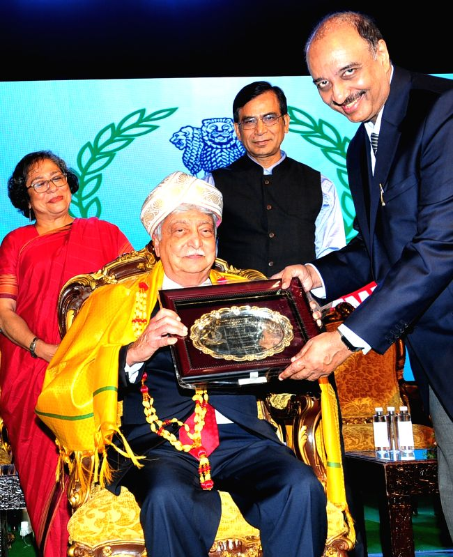 Wipro Chairman Azim Premji being felicitated during the 158th Income Tax Day celebrations, in Bengaluru on July 24, 2018.