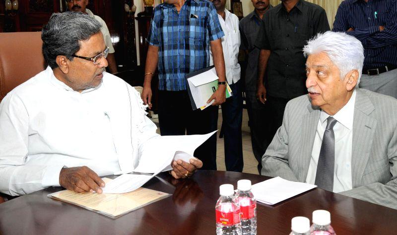 WIPRO Chairman Azim Premji during a meeting with Karnataka Chief Minister Siddaramaiah at Vidhana Soudha in Bangalore on July 1, 2014. - Siddaramaiah