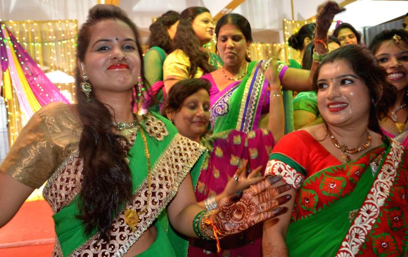 Woman`s celebrate Teej festival in Lucknow on August 2, 2014.